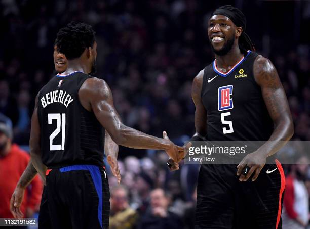 Montrezl Harrell of the LA Clippers celebrates his dunk with Patrick Beverley after a Dallas Mavericks timeout during the first half at Staples...