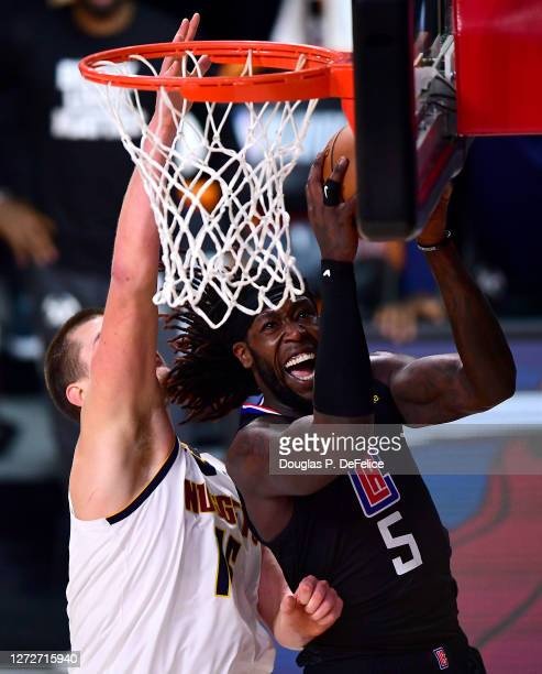 Montrezl Harrell of the LA Clippers drives to the basket against Nikola Jokic of the Denver Nuggets during the third quarter in Game Seven of the...