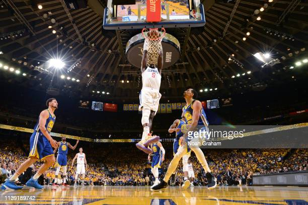Montrezl Harrell of the LA Clippers dunks the ball against the Golden State Warriors during Game Five of Round One of the 2019 NBA Playoffs on April...