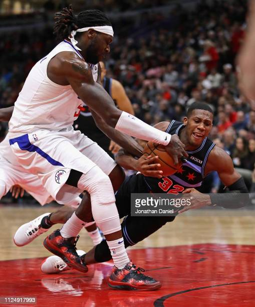 Montrezl Harrell of the LA Clippers forces a jump ball with Kris Dunn of the Chicago Bulls at the United Center on January 25 2019 in Chicago...
