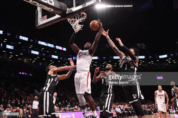 Montrezl Harrell of the LA Clippers grabs a rebound against D'Angelo Russell of the Brooklyn Nets during the game at Barclays Center on February 12...