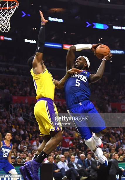 Montrezl Harrell of the LA Clippers is fouled by LeBron James of the Los Angeles Lakers during the first half in the LA Clippers season home opener...