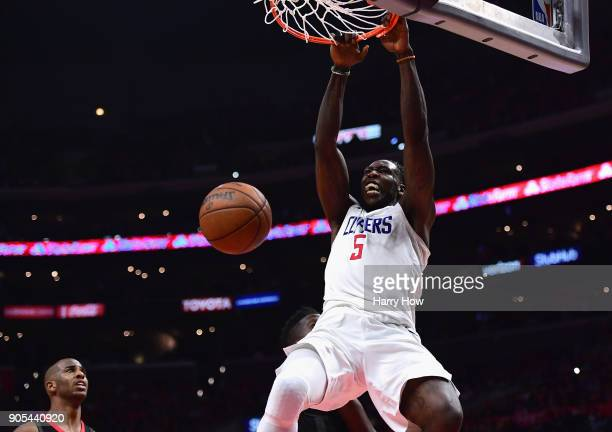 Montrezl Harrell of the LA Clippers reacts as he dunks the ball in front of Chris Paul of the Houston Rockets during a 113102 Clipper win at Staples...