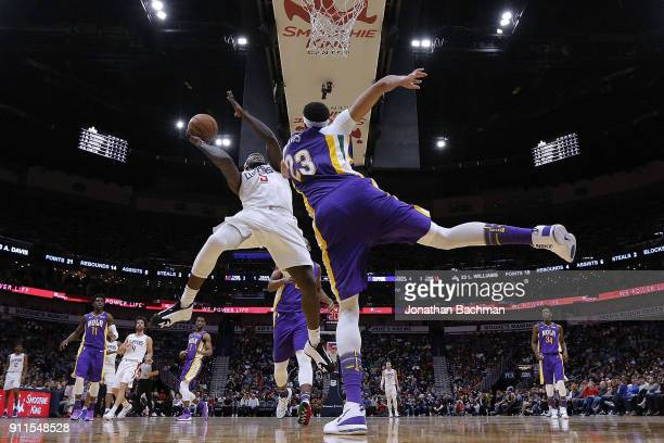 Montrezl Harrell of the LA Clippers shoots against Anthony Davis of the New Orleans Pelicans during the second half at the Smoothie King Center on...
