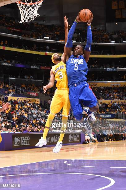 Montrezl Harrell of the LA Clippers shoots the ball against Corey Brewer of the Los Angeles Lakers during the game on October 19 2017 at STAPLES...
