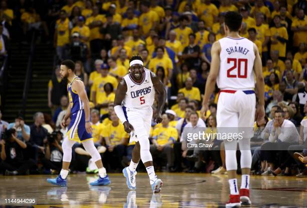 Montrezl Harrell of the LA Clippers smiles as he runs back downcourt after making a basket against the Golden State Warriors during Game Five of the...
