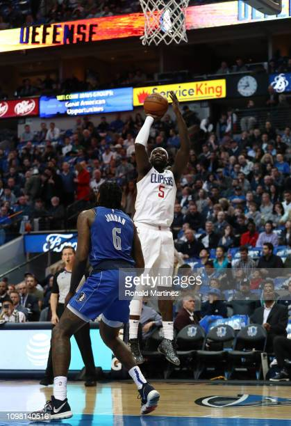Montrezl Harrell of the LA Clippers takes a shot against DeAndre Jordan of the Dallas Mavericks in the first half at American Airlines Center on...