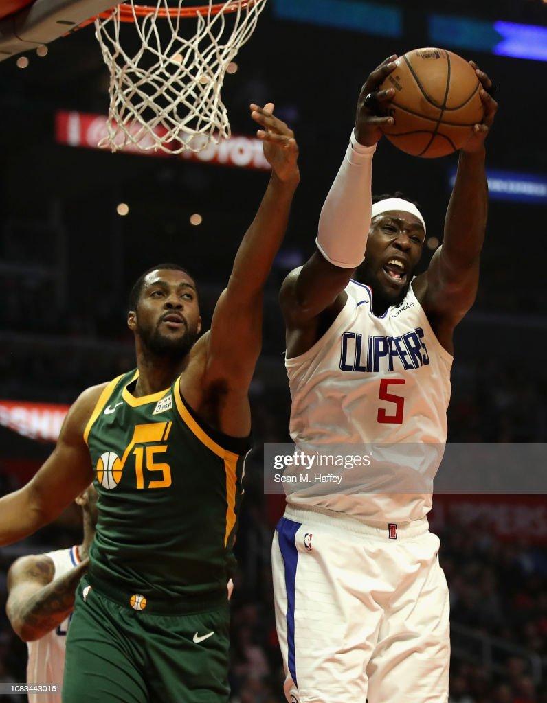 97335e74d767 Montrezl Harrell of the Los Angeles Clippers battles Derrick Favors ...