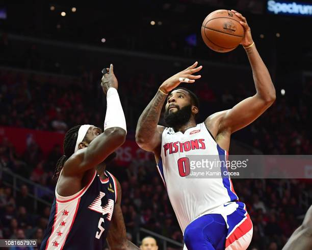 Montrezl Harrell of the Los Angeles Clippers defends a shot by Andre Drummond of the Detroit Pistons in the second half of the game at Staples Center...