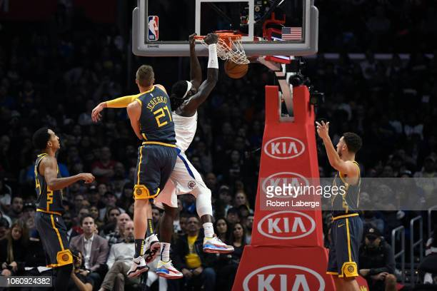 Montrezl Harrell of the Los Angeles Clippers dunks the ball against Jonas Jerebko of the Golden State Warriors on November 12 2018 at STAPLES Center...