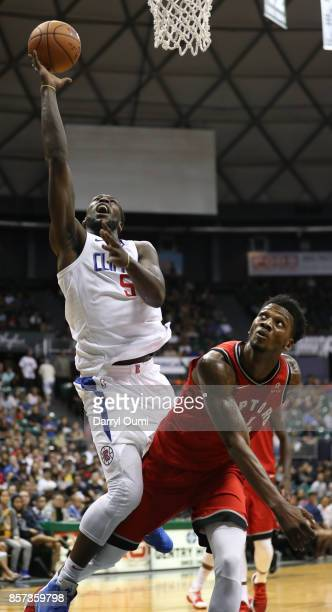 Montrezl Harrell of the Los Angeles Clippers finishes and makes his shot after being fouled by Alfonzo McKinnie of the Toronto Raptors during the...