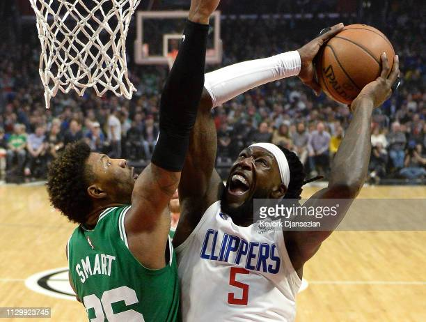 Montrezl Harrell of the Los Angeles Clippers goes up for a layup against Marcus Smart of the Boston Celtics during the first half at Staples Center...