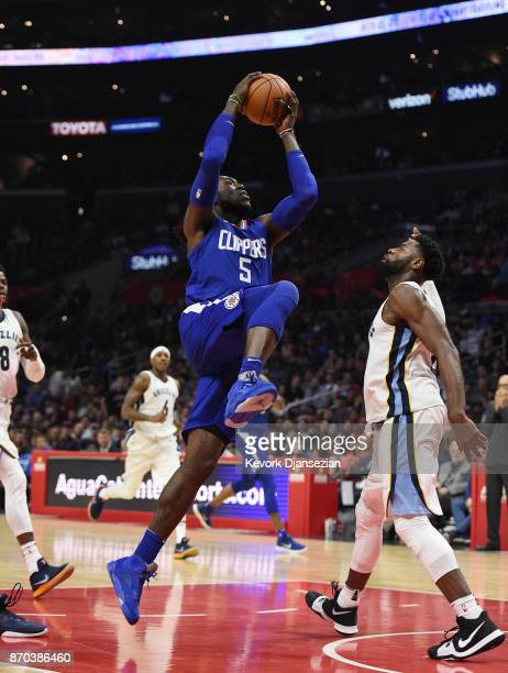 Montrezl Harrell of the Los Angeles Clippers goes up for a layup against James Ennis III of the Memphis Grizzlies during the second half of the...
