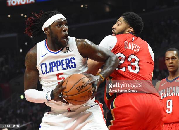 Montrezl Harrell of the Los Angeles Clippers looks to shoot against Anthony Davis of the New Orleans Pelicans in the first half of the game at...