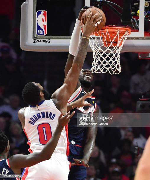 Montrezl Harrell of the Los Angeles Clippers makes a block as Andre Drummond of the Detroit Pistons goes for a dunk in the first half of the game at...