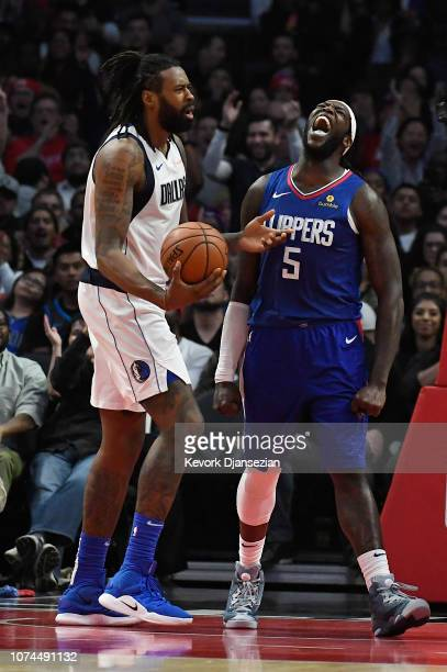Montrezl Harrell of the Los Angeles Clippers reacts after scoring and getting fouled by DeAndre Jordan of the Dallas Mavericks during the second...