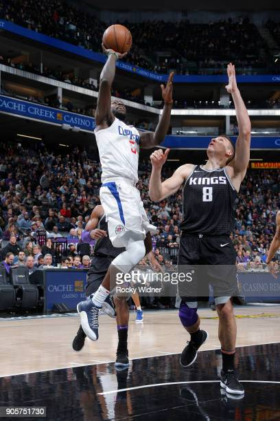 Montrezl Harrell of the Los Angeles Clippers shoots against Bogdan Bogdanovic of the Sacramento Kings on January 11 2018 at Golden 1 Center in...