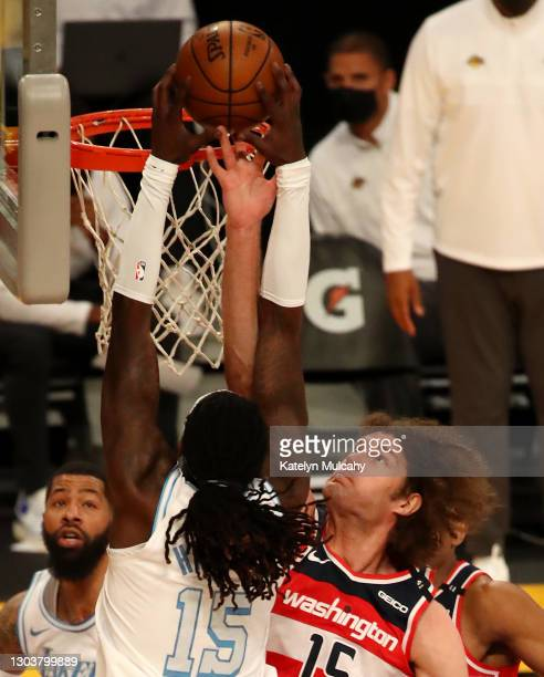 Montrezl Harrell of the Los Angeles Lakers dunks the ball against Robin Lopez of the Washington Wizards during the second quarter at Staples Center...
