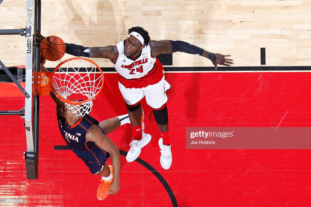 Montrezl Harrell #24 of the Louisville Cardinals blocks a shot against Darion Atkins #5 of the Virginia Cavaliers during the game at KFC Yum! Center on March 7, 2015 in Louisville, Kentucky. Louisville defeated Virginia 59-57.