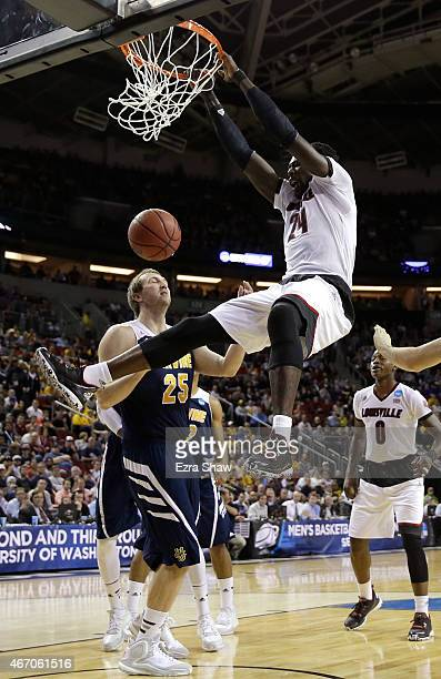 Montrezl Harrell of the Louisville Cardinals dunks against John Ryan of the UC Irvine Anteaters in the first half during the second round of the 2015...