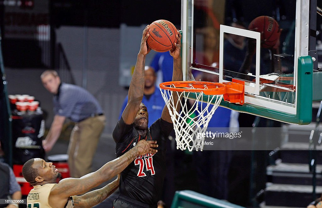 Montrezl Harrell #24 of the Louisville Cardinals dunks over Toarlyn Fitzpatrick #32 of the South Florida Bulls during the game at the Sun Dome on February 17, 2013 in Tampa, Florida.