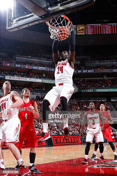 Montrezl Harrell of the Louisville Cardinals dunks the ball against the Hartford Hawks during the game at KFC Yum Center on November 19 2013 in...