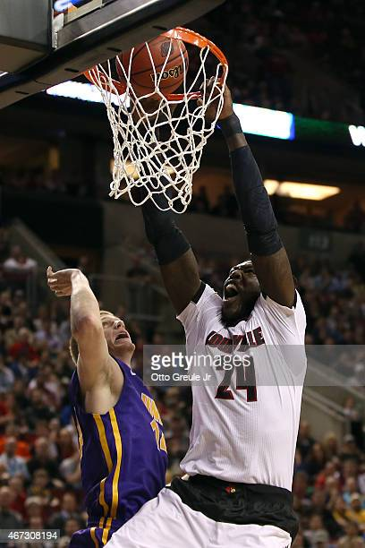 Montrezl Harrell of the Louisville Cardinals dunks the ball over Nate Buss of the Northern Iowa Panthers in the first half of the game during the...