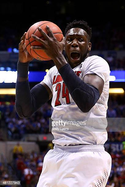 Montrezl Harrell of the Louisville Cardinals rebounds the ball against the Kentucky Wildcats during the regional semifinal of the 2014 NCAA Men's...