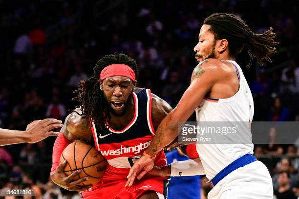 Montrezl Harrell of the Washington Wizards is defended by Derrick Rose of the New York Knicks during a preseason game at Madison Square Garden on...