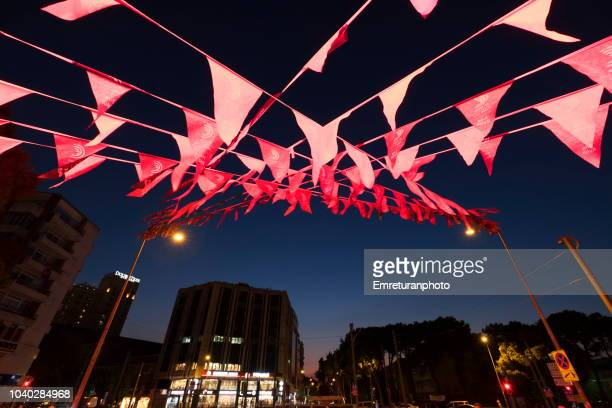 montro square with illuminted decorative flags above at night. - emreturanphoto stock pictures, royalty-free photos & images