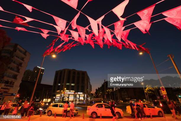 montro square with parked taxis and illuminated decorations at night in izmir. - emreturanphoto stock pictures, royalty-free photos & images