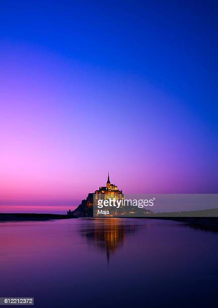 mont-saint-michel at dawn - unesco stock pictures, royalty-free photos & images