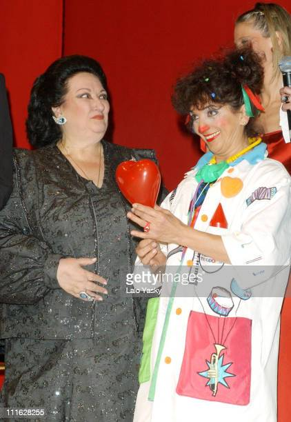 Montserrat Caballe accompanied by Doctor Clown of the Theodora Foundation gives a check to the President of the Theodora Foundation during a benefit...