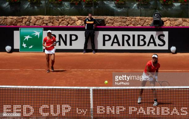 Montserrat Gonzalez and Veronica Cepede of Paraguay in action in their doubles match against Georgina Garca Perez and Maria Jose Martnez of Spain...