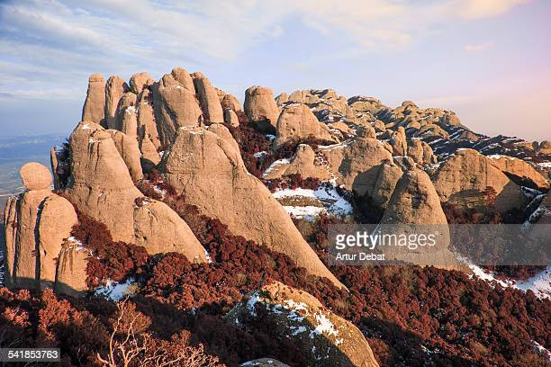 montserrat mountain range with snow on sunset - conglomerate stock pictures, royalty-free photos & images