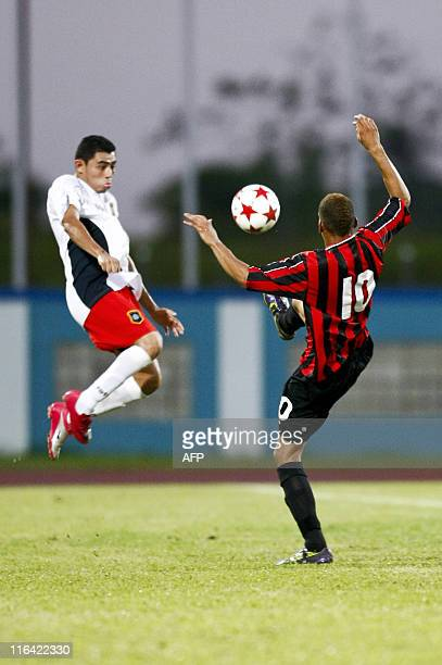Montserrat's Hodgson Jay Lee and Brelize's Mendez Luis fight for the ball during their qualification World Cup 2014 football match at Ato Boldon...