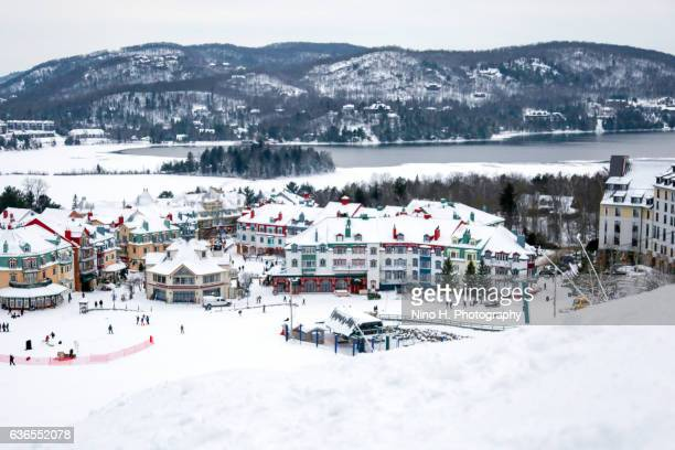 mont-tremblant ski village in winter - mont tremblant stock pictures, royalty-free photos & images