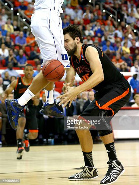 Monty Brown of the Mercer Bears is hit in the head by the knee of Jabari Parker of the Duke Blue Devils in the first half in the second round of the...
