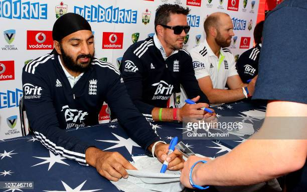Monty Panesar and Kevin Pietersen of England sign autographs for fans during an Ashes fan day at Queensbridge Square on December 23, 2010 in...