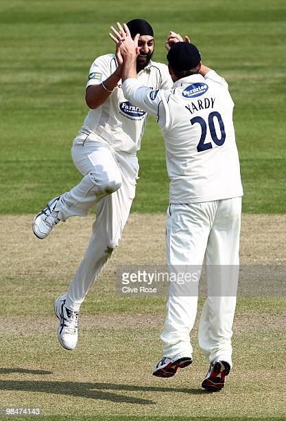 Monty Panesar and Michael Yardy of Sussex celebrates the wicket of Steve Davies of Surrey during the LV County Championship Division Two match...