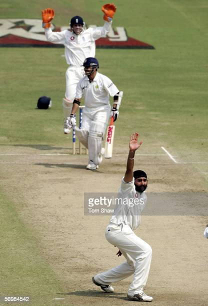 Monty Panesar of England appeals for and gets the wicket of Sachin Tendulkar of India during day three of the First Test between India and England at...