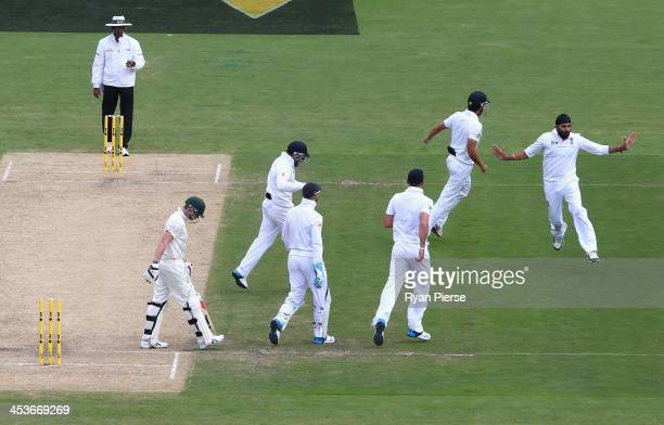 Monty Panesar of England celebrates after taking the wicket of Steve Smith of Australia during day one of the Second Ashes Test Match between...