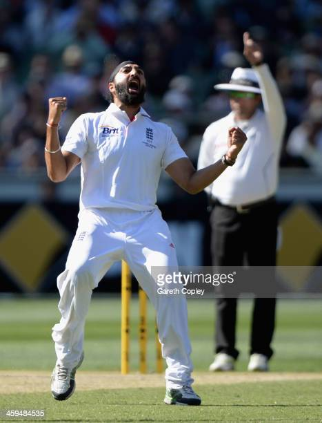 Monty Panesar of England celebrates dismissing Brad Haddin of Australia the decision was reversed after an review to the 3rd umpire during day two of...
