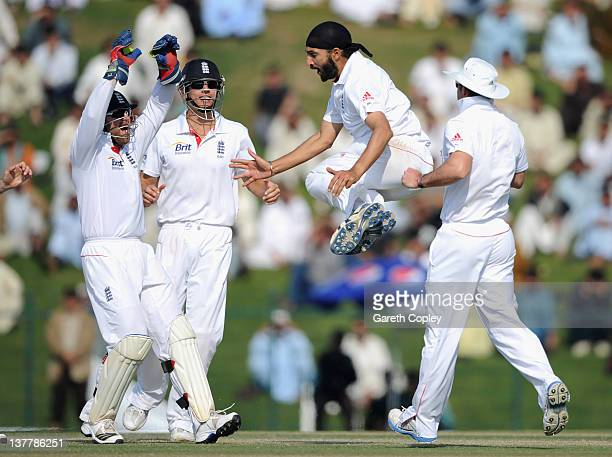 Monty Panesar of England celebrates dismissing Pakistan captain MisbahulHaq during the second Test match between Pakistan and England at Sheikh Zayed...