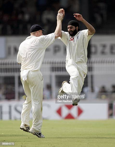 Monty Panesar of England celebrates taking the wicket of Sachin Tendulkar of India with Andrew Flintoff during day three of the First Test between...