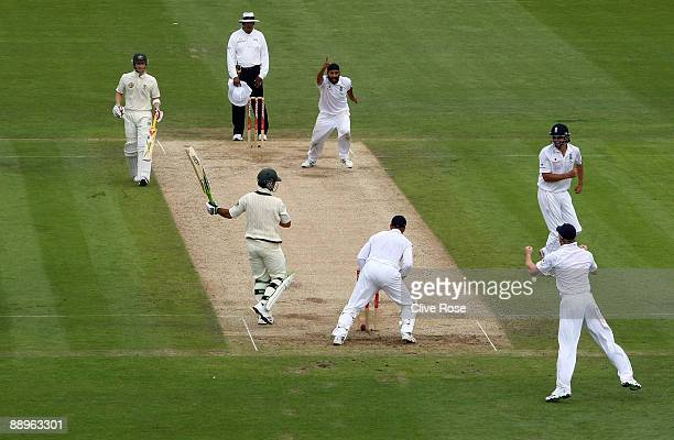 Monty Panesar of England celebrates the wicket of Ricky Ponting of Australia during day three of the npower 1st Ashes Test Match between England and...