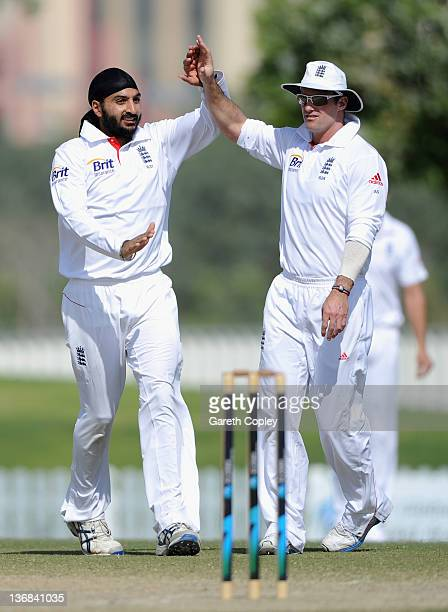 Monty Panesar of England celebrates with captain Andrew Strauss after dismissing Yasir Shah of Pakistan Cricket Board XI during the tour match...