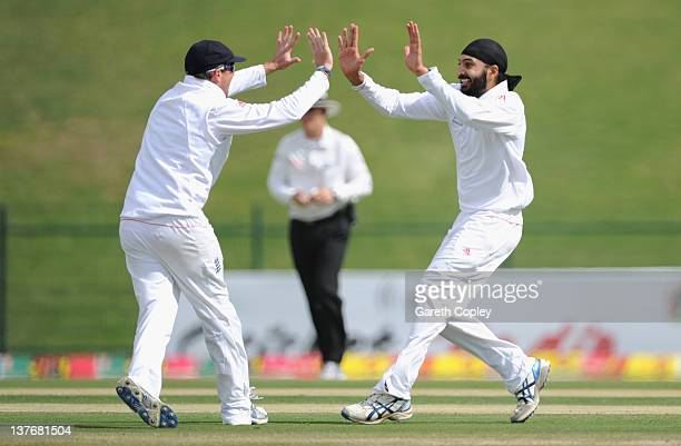 Monty Panesar of England celebrates with Graeme Swann dismissing Mohammad Hafeez of Pakistan during the second Test match between Pakistan and...