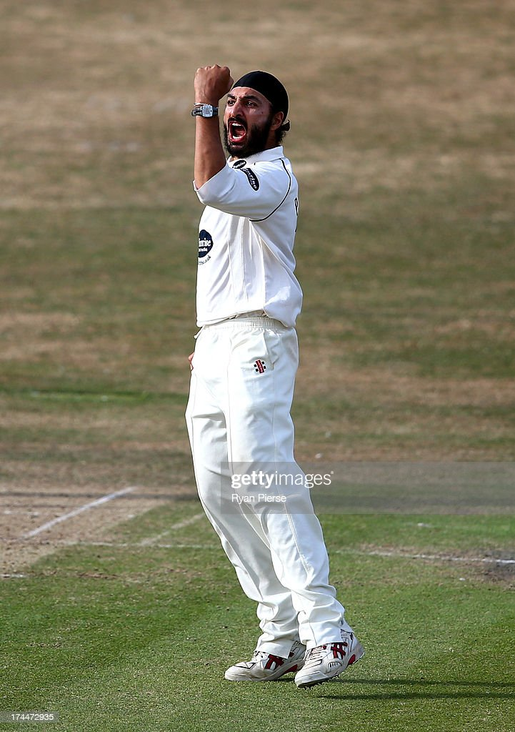 Monty Panesar of Sussex celebrates after taking the wicket of James Faulkner of Australia during Day One of the Tour Match between Sussex and Australia at The County Ground on July 26, 2013 in Hove, England.