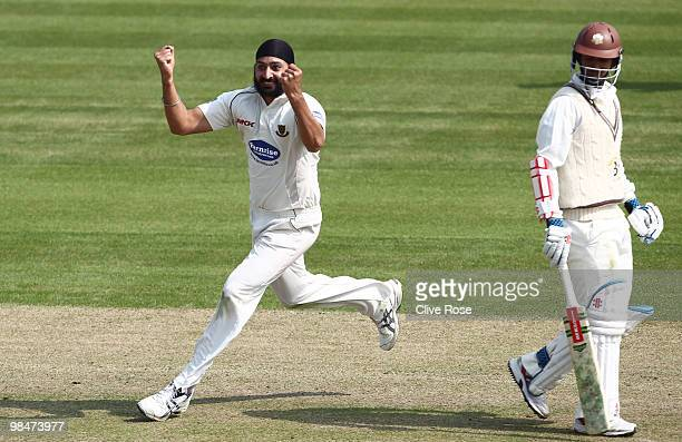 Monty Panesar of Sussex celebrates the wicket of Steve Davies of Surrey during the LV County Championship Division Two match between Sussex and...